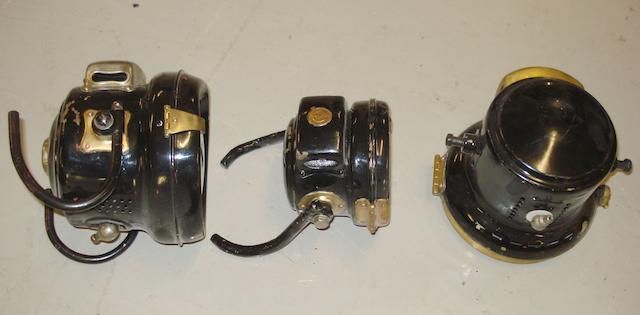 Three acetylene motorcycle headlamps,