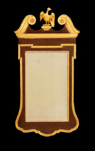A late 19th/early 20th century George II style mahogany and parcel gilt mirror