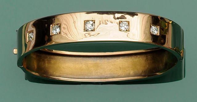 A diamond set hinged bangle