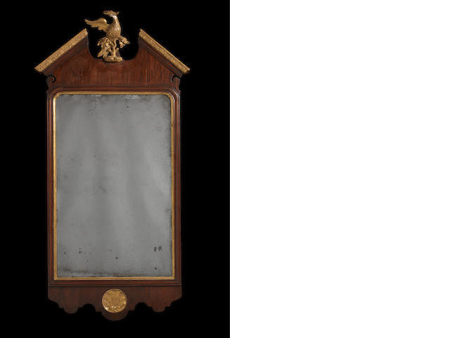 A George II mahogany and parcel gilt wall mirror