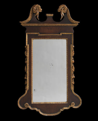 A George II mahogany and parcel-gilt wall mirror