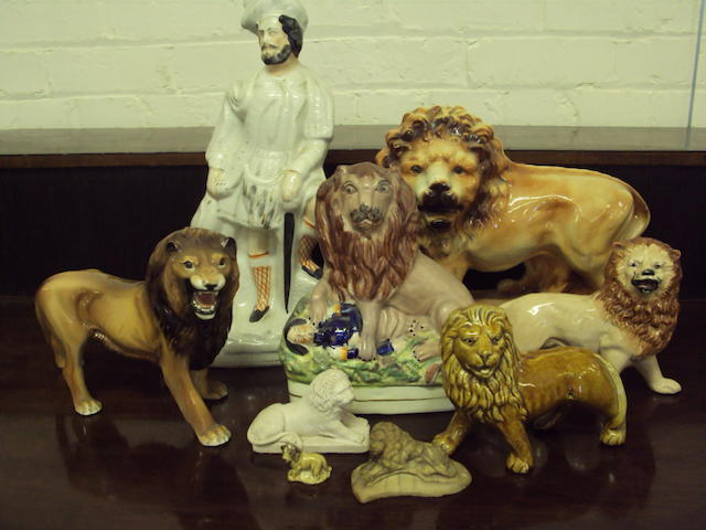 A group of ceramic lion figures