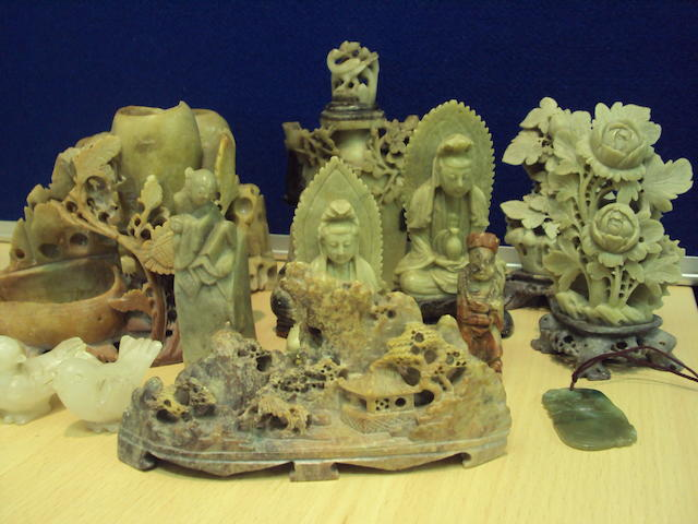 A group of Chinese soapstone and hardstone carvings