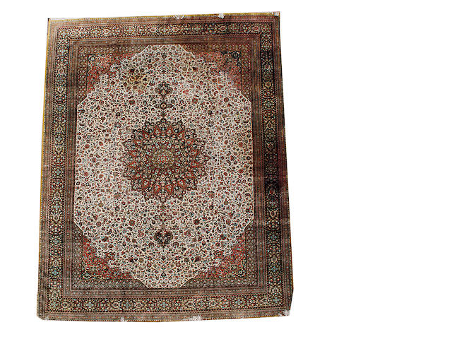 A silk Ghom carpet, Central Persia, 406cm x 311cm