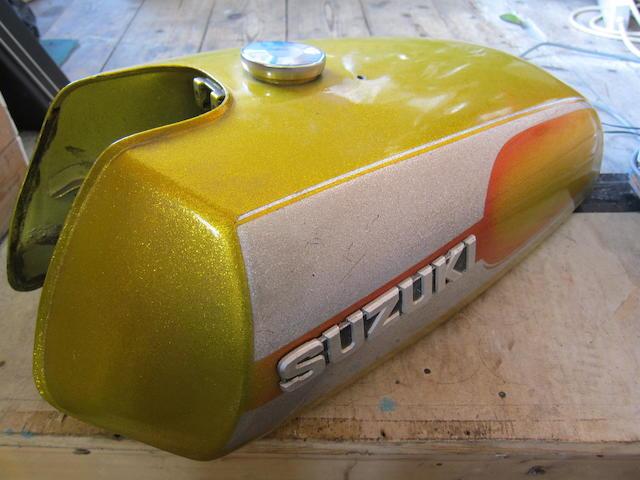 A Suzuki 'gold-flake' petrol tank,