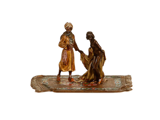 An early 20th century Viennese cold painted bronze model of a slave seller and a female slave