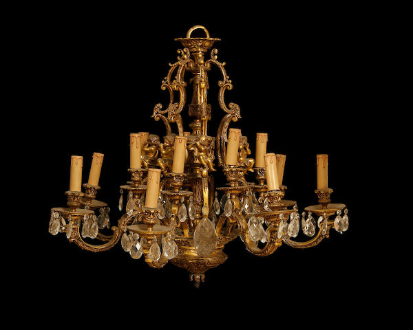 A Louis XV style gilt metal and cut glass fourteen light chandelier