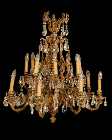A large Louis XVI style gilt metal and cut glass sixteen light chandelier