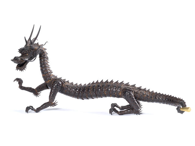 A fine, rare and small iron jizai (fully articulated) okimono of a dragon By Myochin Kiyoharu, Edo Period, 18th/19th century