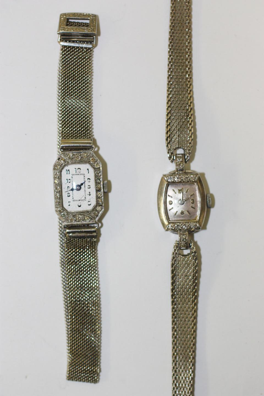 Four diamond set lady's wristwatches(4)