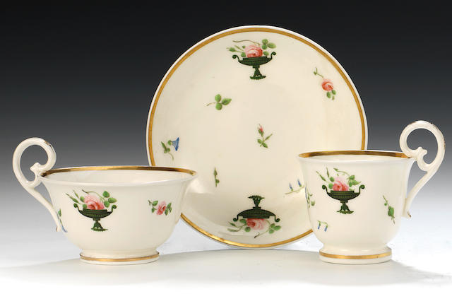 A Nantgarw teacup, coffee cup and saucer with the Prince of Wales pattern