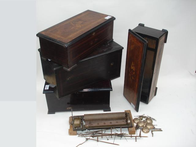 A bell-en-vue movement and various cylinder musical box cases: