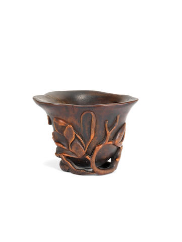 A rhinoceros horn 'magnolia' libation cup 17th/18th century