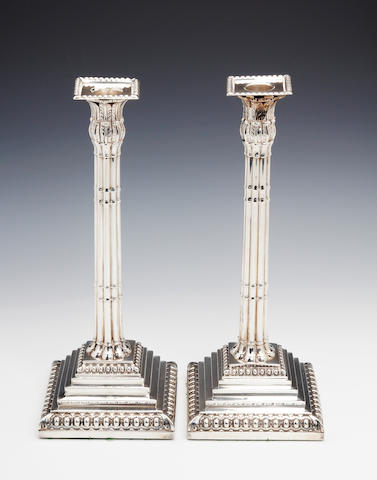 A George III pair of fluted candlesticks by John Verlander, London 1765