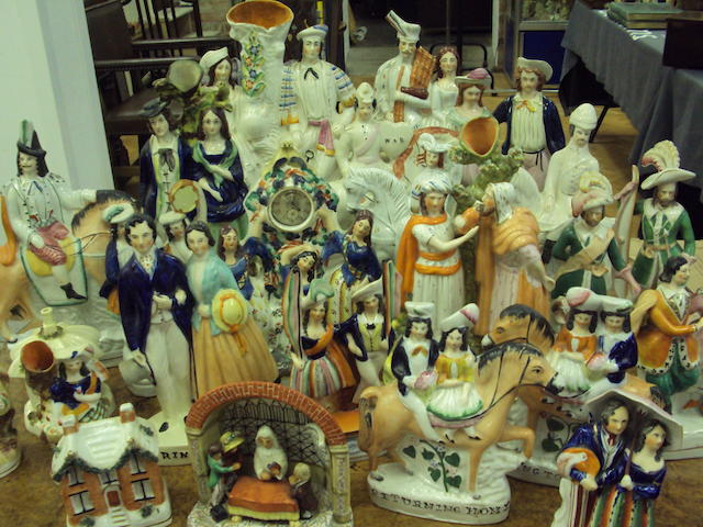 A collection of twenty four Staffordshire figures