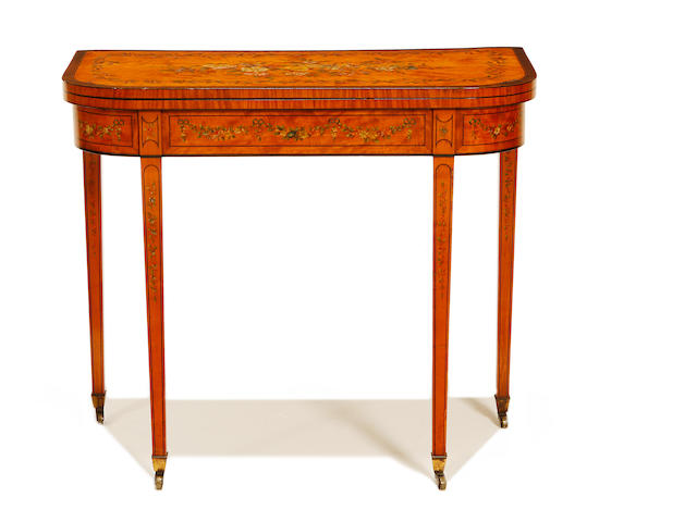 A late George III satinwood and polychrome decorated D-shaped card table in the manner of Thomas Sheraton