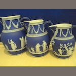 A set of three graduated Wedgwood jugs