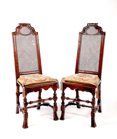 A pair of William & Mary walnut side chairs,the tall backs and seats caned, turned underframes with braganza front feet (2)
