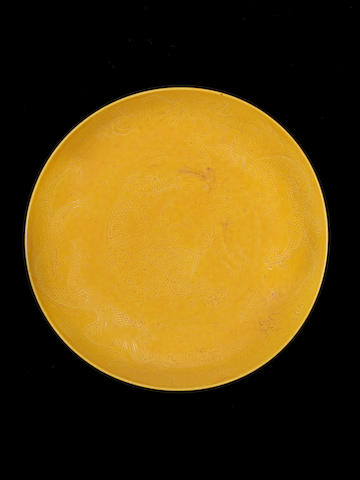An incised yellow-glazed saucer dish Guangxu six-character mark and of the period