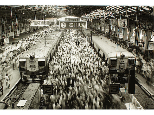 Sebastião Salgado (Brazilian, born 1944) Church Gate Station, Bombay, 1995 Paper 50.5 x 60.8cm (19 7/8 x 23 15/16in), image 34.6 x 52cm (13 5/8 x 20 1/2in).