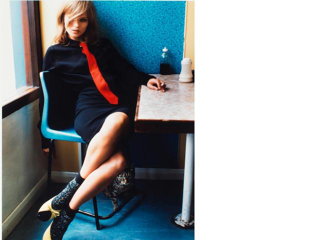Mario Testino (Peruvian/Italian, born 1954) Kate Moss in Blue Café, 2005 Paper 60.4 x 47.8cm (23 3/4 x 18 13/16in), image 51.9 x 40.5cm (20 7/16 x 15 15/16in)