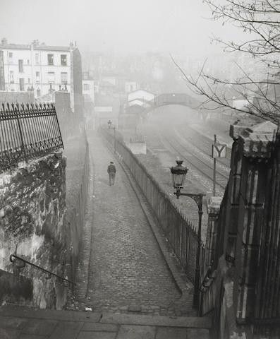 Willy Ronis (French, 1910-2009) Petite Ceinture depuis la rue de Ménilmontant, DATE? Paper 40.4 x 30.5cm (15 7/8 x 12in), image 31.4 x 25.8cm (12 3/8 x 10 1/8in).