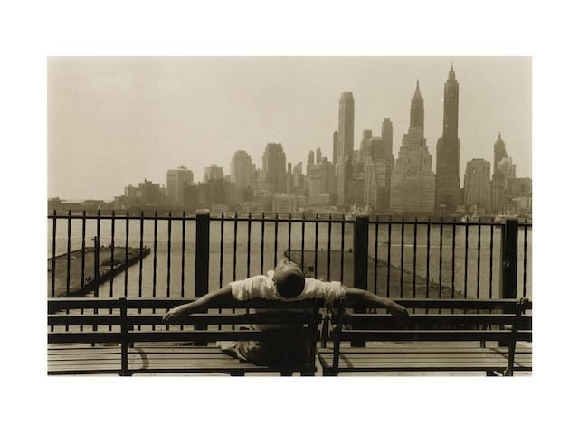 Louis Stettner (American, born 1922) Promenade, New York, 1954 Paper 27.8 x 35.5cm (10 15/16 x 14in), image 19.6 x 29.7cm (7 3/4 x 11 11/16in).