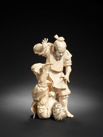 A Tokyo School ivory okimono group of two warriors By Shimamura Toshiaki/Shunmei (1855-1896), Meiji Period