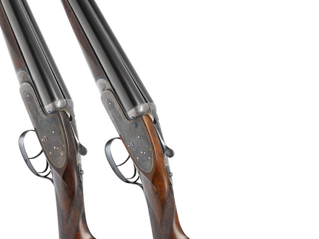 A fine pair of 12-bore (2 5/8in) self-opening sidelock ejector guns by J. Purdey & Sons, no. 24108/9 Formerly the property of H.L. Visser In their brass-mounted oak and leather case with makers accessories and later canvas cover