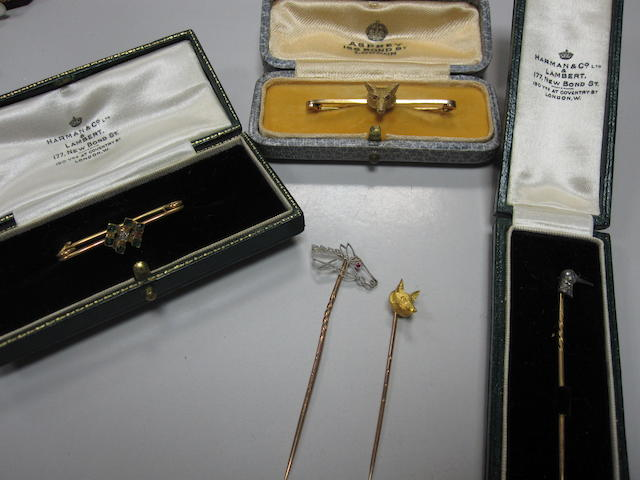 A small collection of sporting stickpins and bar brooches (5)
