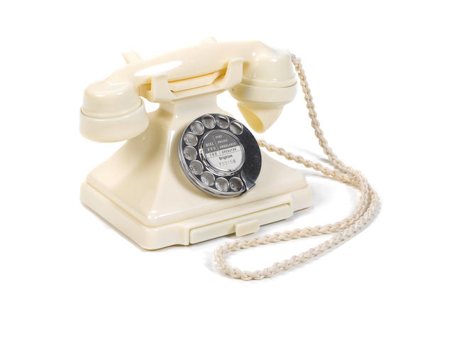 A near-mint 200-series cream bakelite telephone, 1955, impressed mark 164-55,