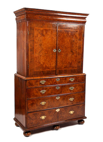 A Queen Anne burr walnut and feather banded secretaire cabinet on chest