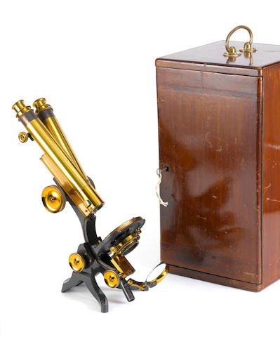 A Swift & Son brass polarising binocular microscope, English, circa 1900, (2)
