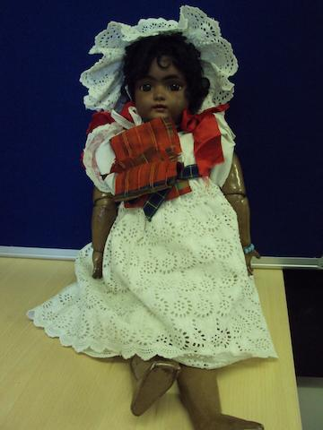 A German bisque 'Mulatto' doll, circa 1910 - 1920