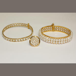 Two gold & pearl bangles and ring