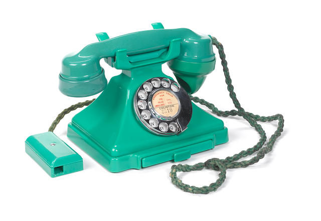 A 200-series green bakelite telephone, impressed mark S-36, base mark FHR56, receiver 1936 and base 1956,