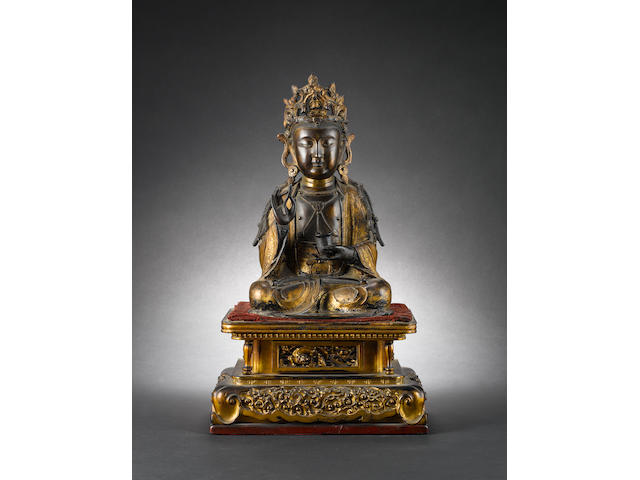 A gilded bronze of a seated Buddhist Deity, possibly Maitreya, Buddha of The Future Ming Dynasty
