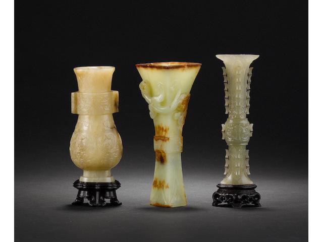 Three jade or hardstone vases of archaistic form