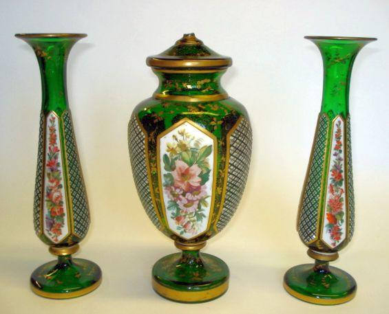 A garniture of green Bohemian and overlay glass vases Late 19th Century
