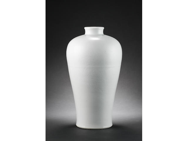 A white monochrome vase of meiping form decorated with a four-clawed dragon