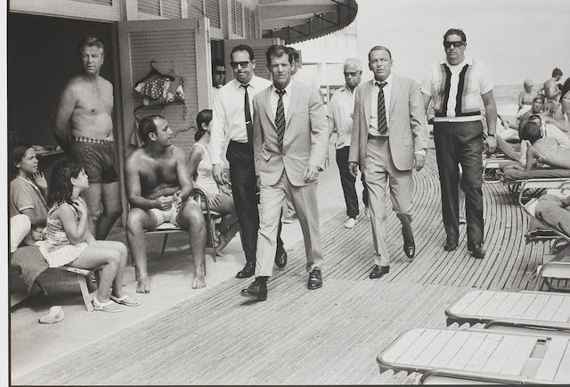 Terry O'Neill (British, born 1938) Frank Sinatra and his bodguards, Miami Beach, 1968 Paper 56.2 x 76cm (22 1/8 x 29 15/16in), image 41.8 x 61.1cm (16 7/16 x 24 1/16in).