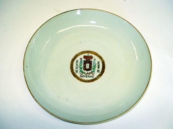 A famille rose armorial dish, from the palace of the Governor of Macau Tongzhi seal mark
