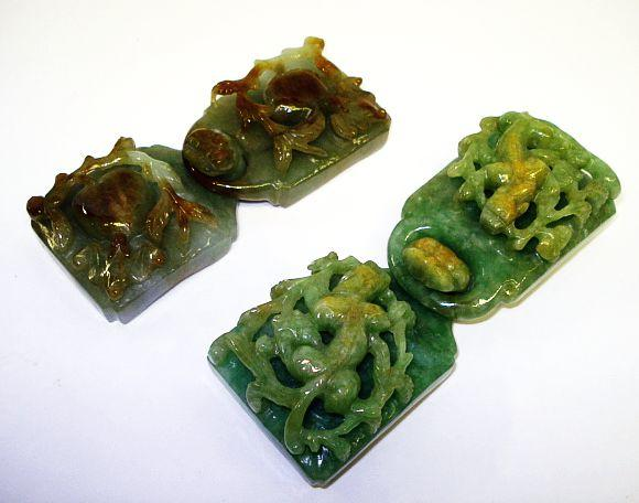 A collection of jadeite belt hooks and slides 20th Century