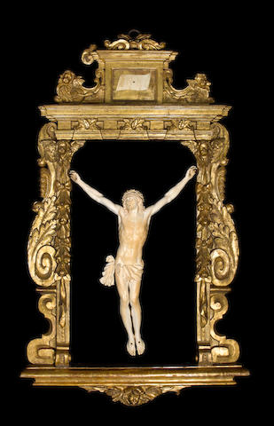 A large and important late 18th / early 19th century ivory Corpus Christi in a Baroque giltwood frame