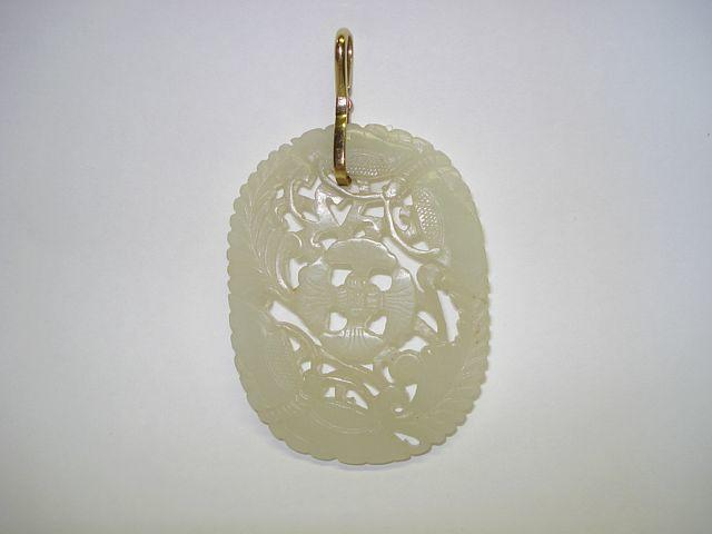 A pale green jade pendant 20th Century