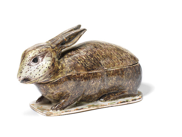 A Continental Faience rabbit tureen and cover