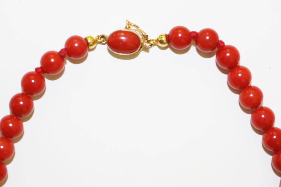 Two single strand red coral bead necklaces