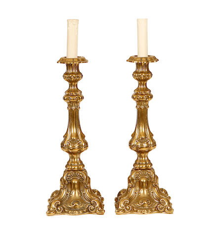 A pair of Victorian brass candlesticks together with a wall light