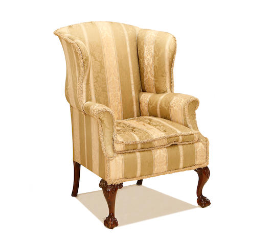 A late Victorian mahogany wingback armchair in the George II style