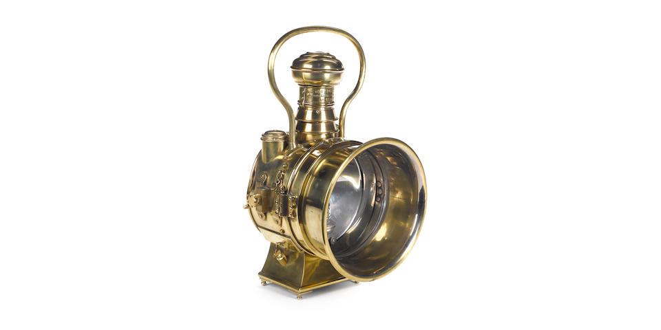 An impressive 'The Polkey' oil illuminating car headlamp,